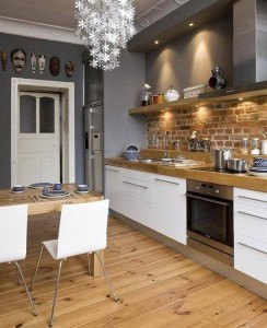 grey kitchen with exposed brick