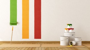 painting a wall with trade paint