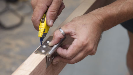 carpenter fitting a door to a property