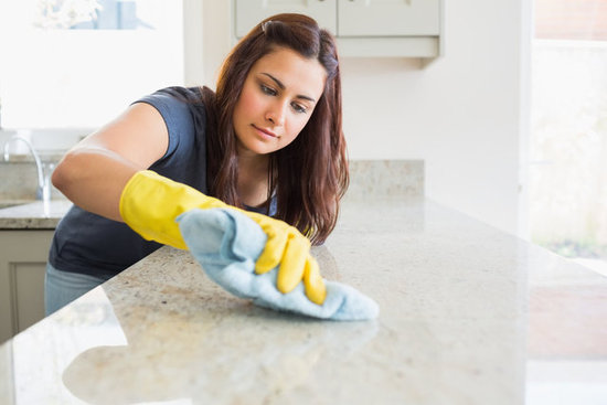 An end of tenancy Cleaner working in a kitchen